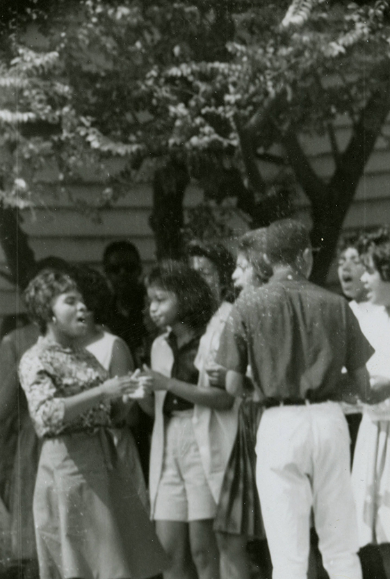 Students sing outside Beulah AME Church Parsonage Aug 1963 rsz.jpg