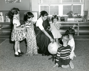 A visitor teaches children about her home in India, Josephine Newbury Demonstration Kindergarten, Richmond, Va.